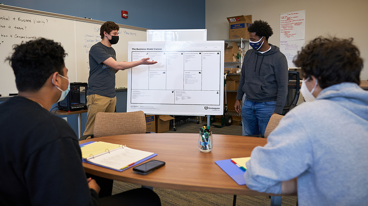Four students collaborating in the Center for Entrepreneurship