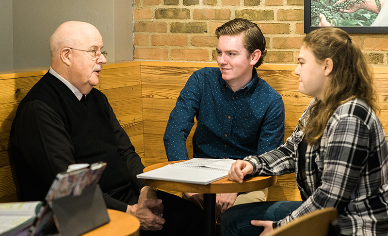 Br. Michael McGinniss with honors program students