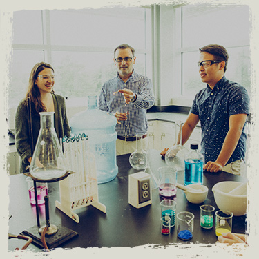 Professor and two students in chemistry lab