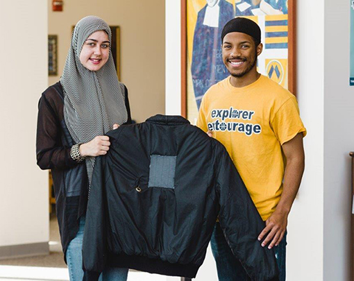 La Salle University freshmen Aliyah Stephens and Jameel Kemp display their invention: a jacket with a solar panel that can recharge a smart phone.