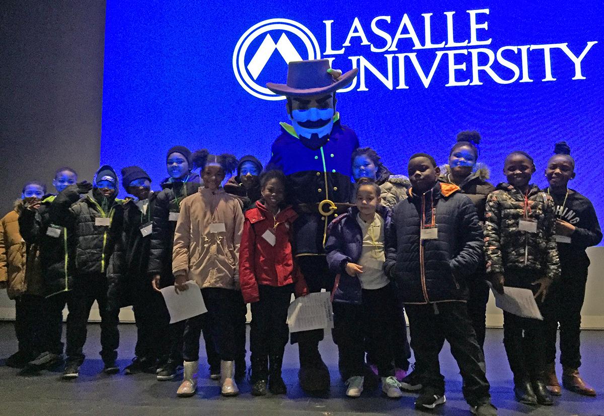 La Salle Explorer with students participating in Junior Achievement program.