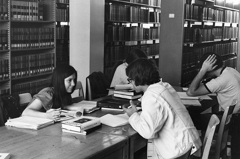 Male and female students in the library at La Salle in 1967