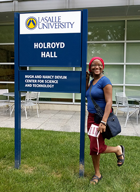 Zaire Watley in front of Holroyd Hall