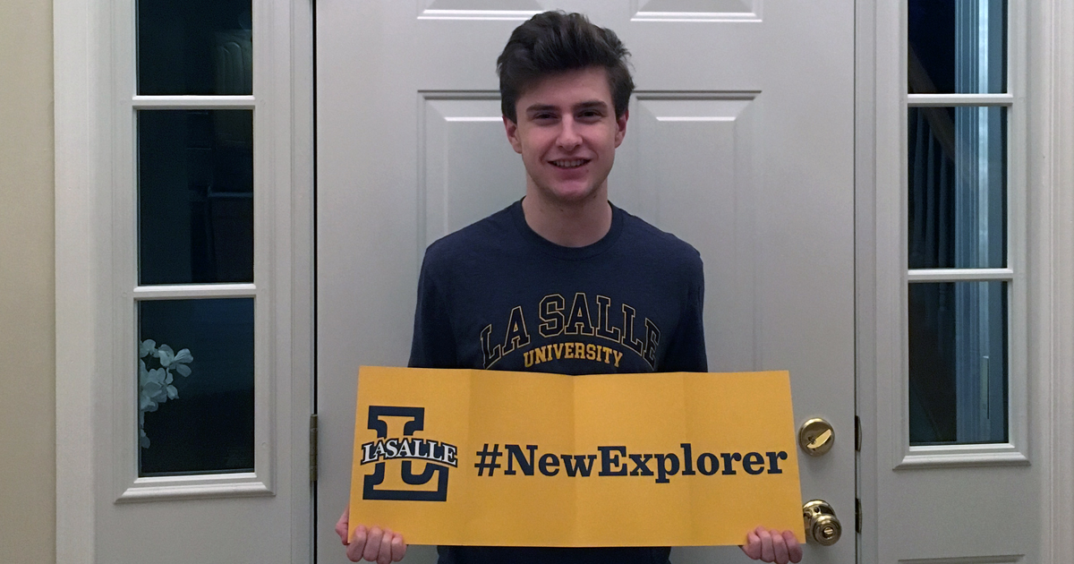 Eric Wilson holding New Explorer sign