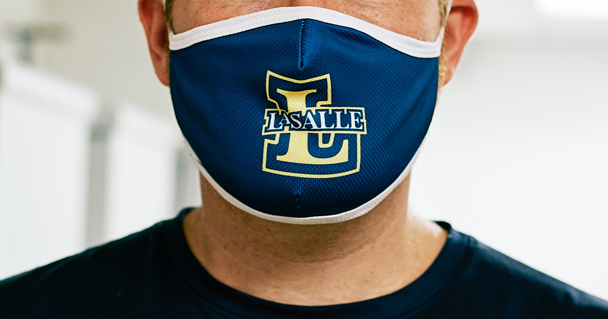 La Salle branded mask worn on student face