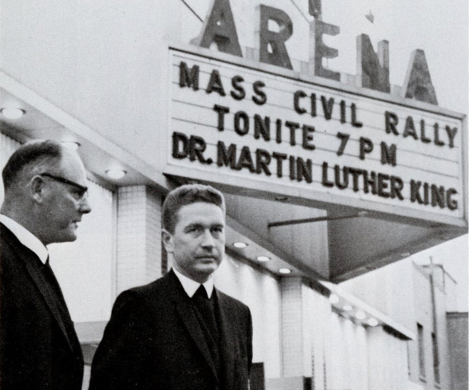 Two Christian Brothers standing outside of Martin Luther King event in 1966