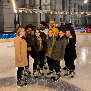 Image of Kate with members of the Wellness and Mindful Living Living Learning Community at the Dilworth Plaza Skating Rink in Philadelphia, November 2019.