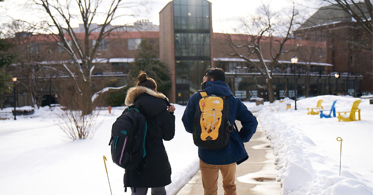Image of students walking on a snowy quad at La Salle University