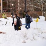 Image of students at La Salle University walking through the snow.