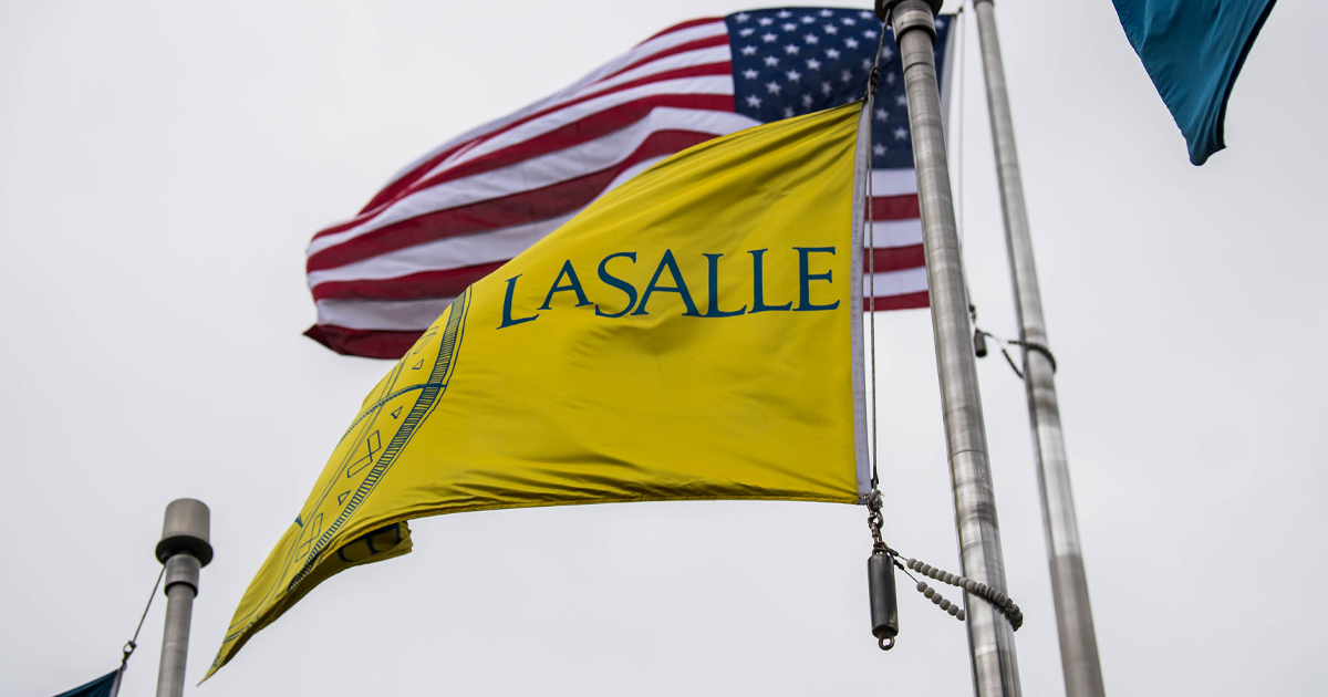 Image of the La Salle University and American flags blowing in the wind.