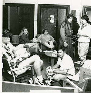 Image of La Salle students gathered at the Center for Community Learning, which offered a program in the 1990s that predates today's Neighborhood Tutoring Program.