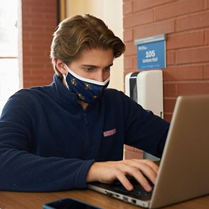 Image of a student wearing a mask at La Salle University.