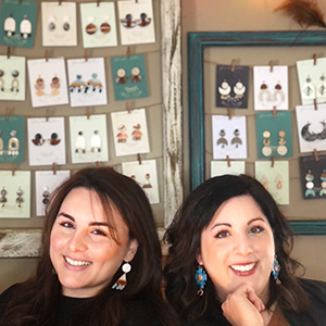 La Salle University student Marni Quevedo, pictured with her sister Jenn, displaying their handmade earrings.