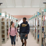 Image of students walking in Connelly Library at La Salle University.