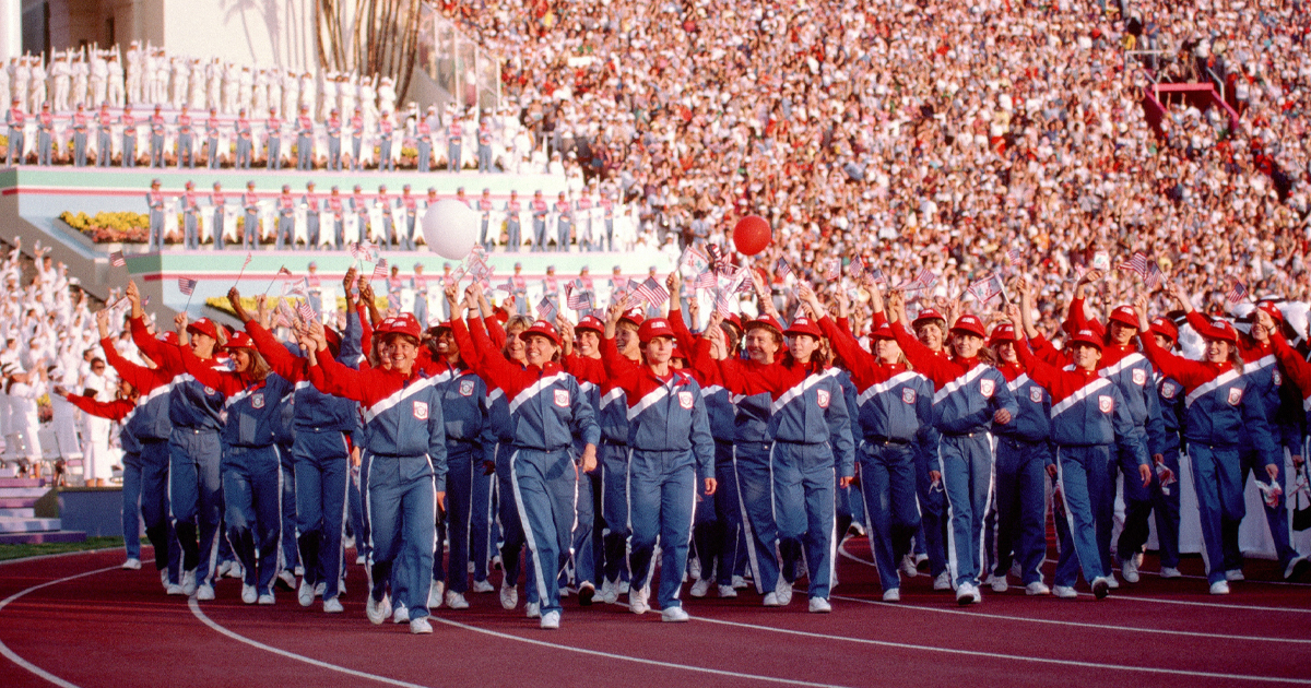 Image of athletes representing the United States, including Diane Moyer, '80, Ph.D., march in a procession at the 1984 Summer Olympics in Los Angeles.