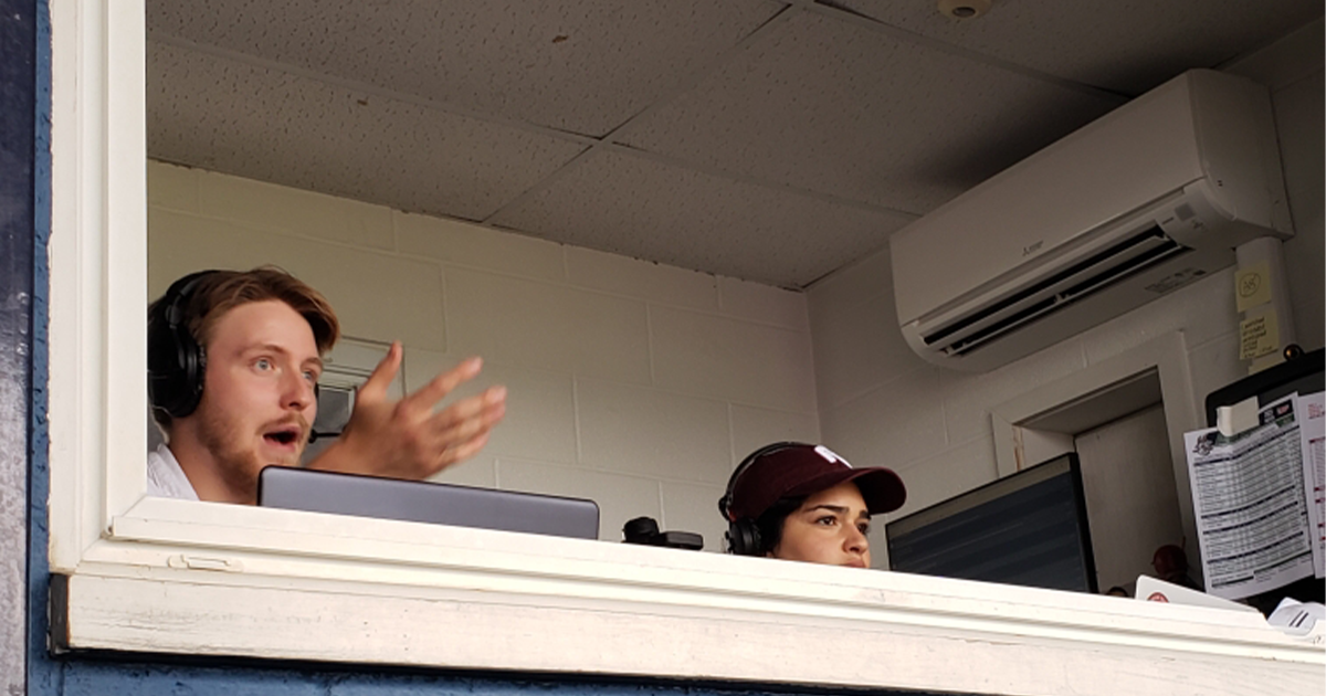 Image of La Salle University student Tyler Small calling a Reading Fightin' Phils game with the team's lead play-by-play announcer, Emily Messina.