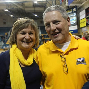 Image of Anna and William Allen at a men's basketball game at La Salle.