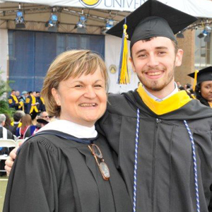 Image of Anna Allen and her son William at the start of the 2014 class.