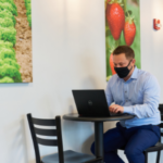 Image of a man sitting in the EatWell Caf