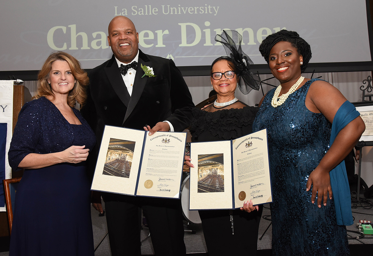 President Hanycz presents awards to Reginald M. Browne, '93 and the Independence Blue Cross Foundation, represented by Rev. Dr. Lorina Marshall-Blake.