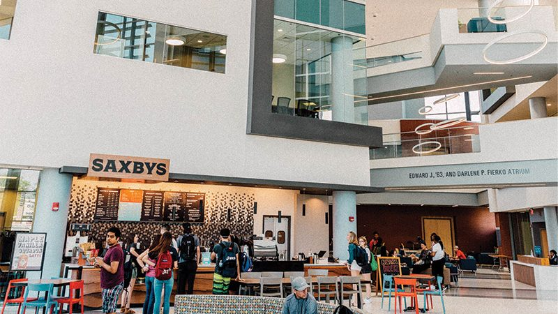 Founders' Hall atrium with Saxbys coffee shop in view and students in the space