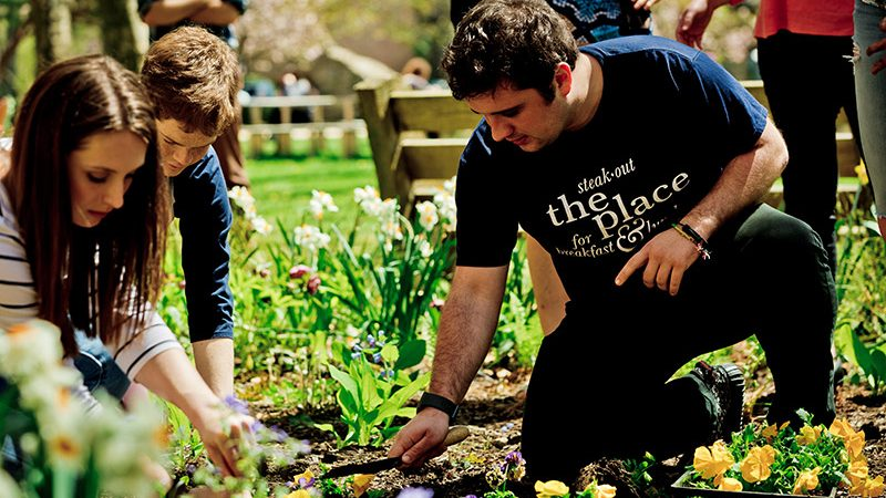 students gardening outside