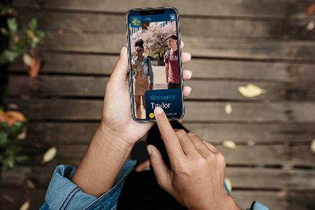 phone in hand displaying custom viewbook website