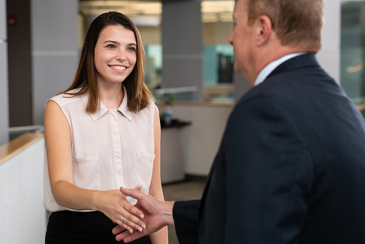 Student Shaking a Professional's Hand