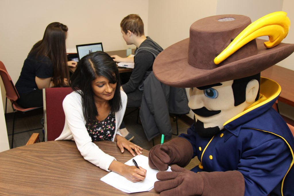students tutoring with la salle explorer mascot