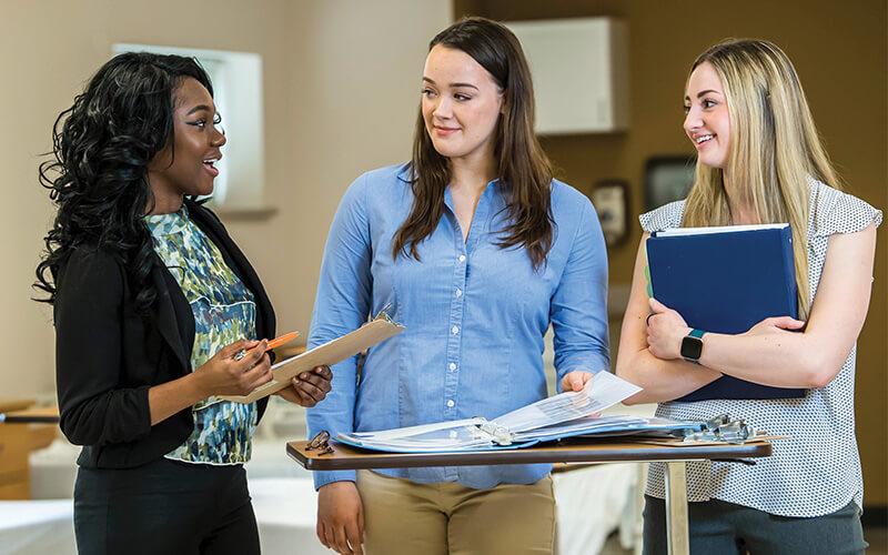 nursing students teamwork in nursing sim lab
