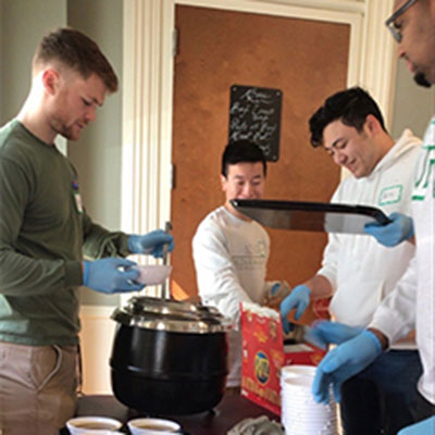 La Salle Students preparing food for Face to Face clients