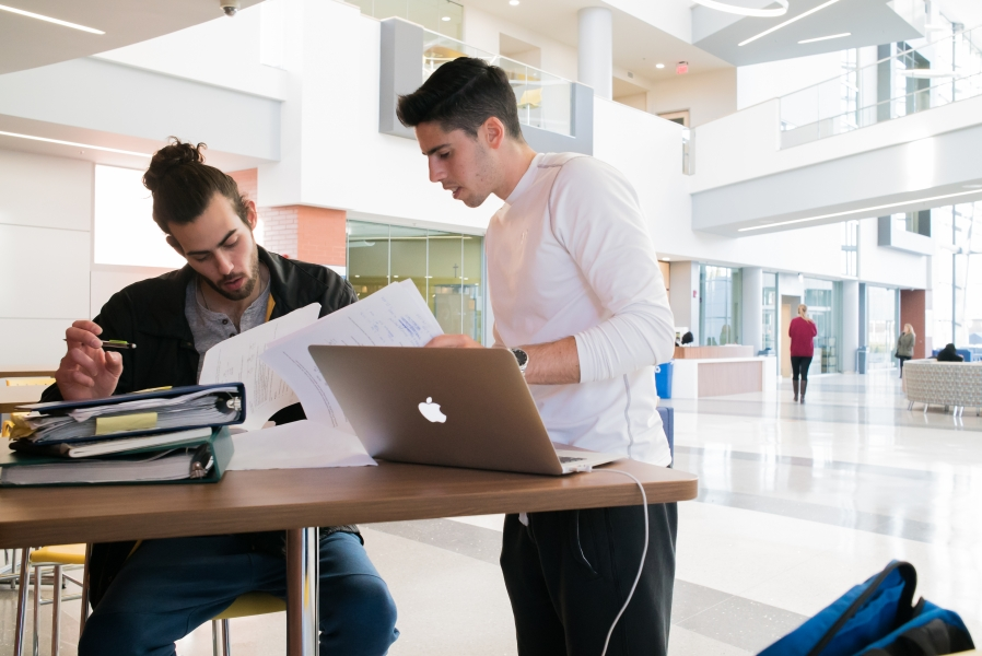 Business School interior, students studying