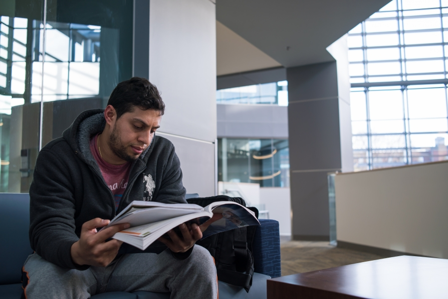 Business School interior, student studying