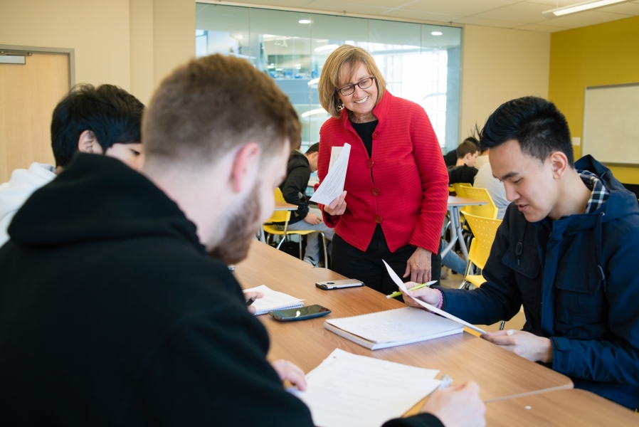 Business School interior, classroom with Lynn Miller